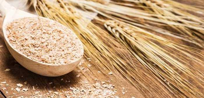En tresleiv med korn og akser med havre