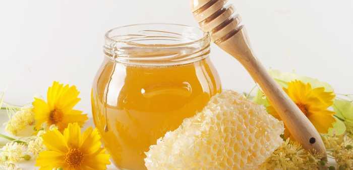 Flytende honning og bit av en honningtavle